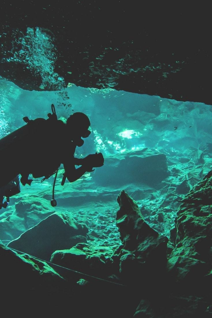 Have you ever tried cenote diving in Mexico? It's one of the 15 amazing travel adventures that really must go on your bucket list. Click to read the full list and see how many you've tried.