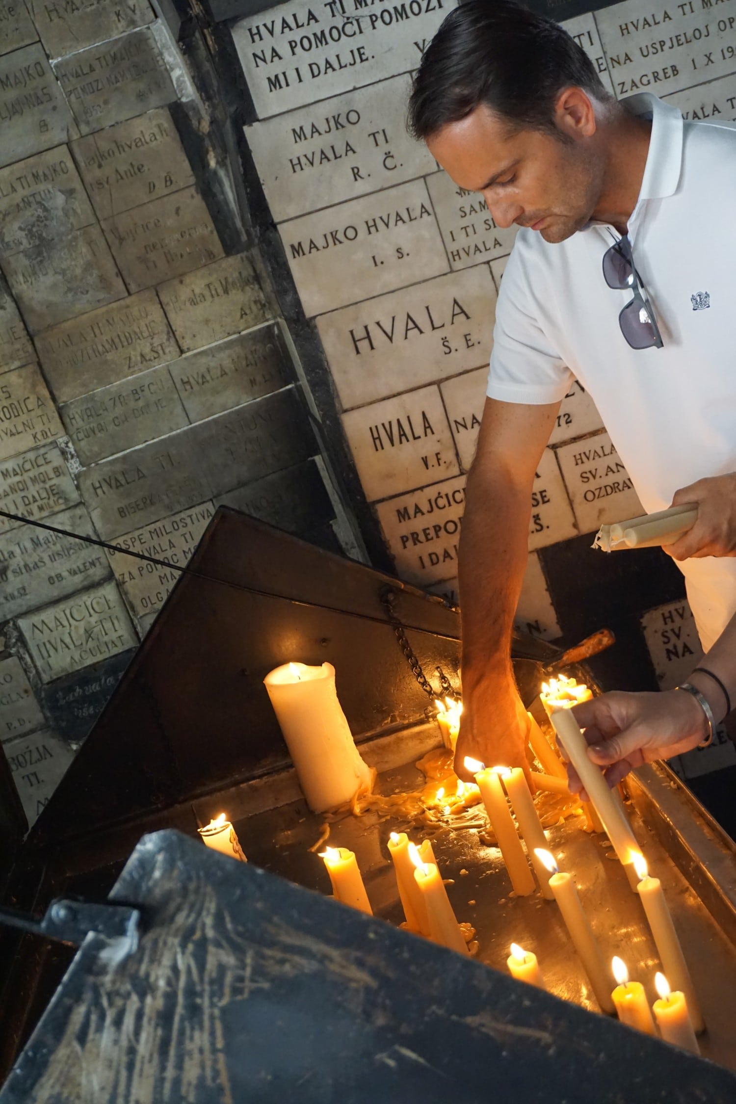 Lighting candles at the Stone Gate in Zagreb
