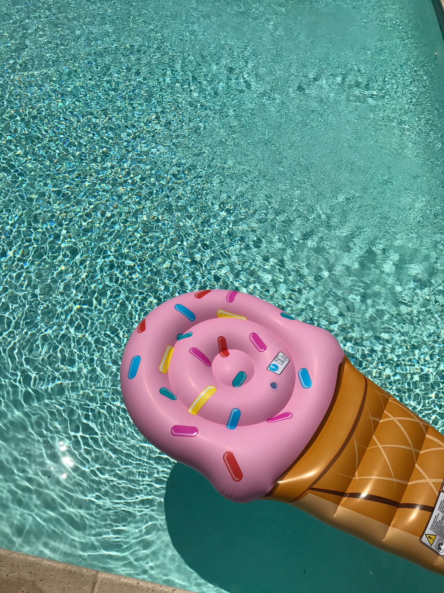 Pool float for a summer staycation. Read our full guide to creating the perfect staycation now.