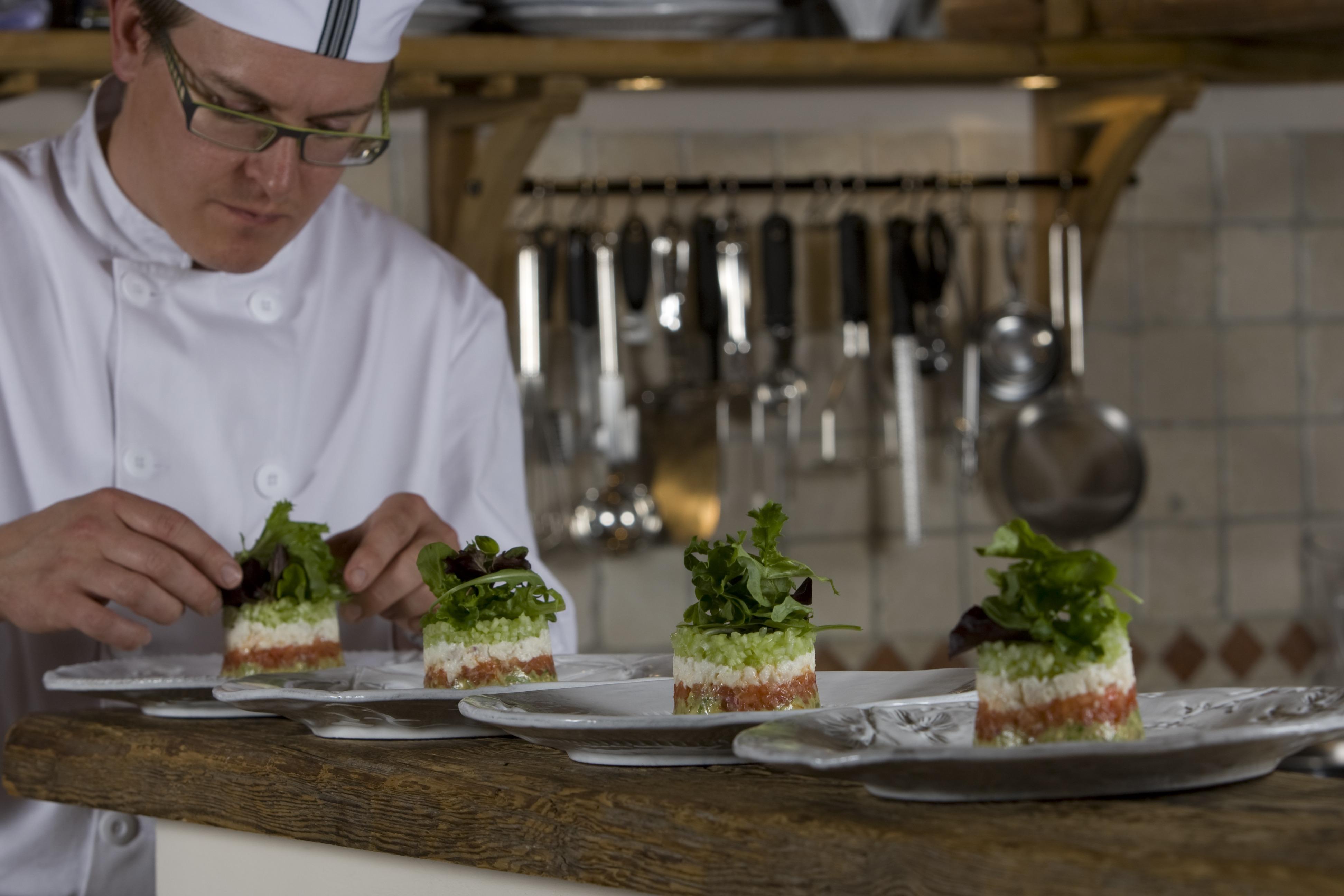 Chef preparing food at Chalet Merlo. pic Mark Junak