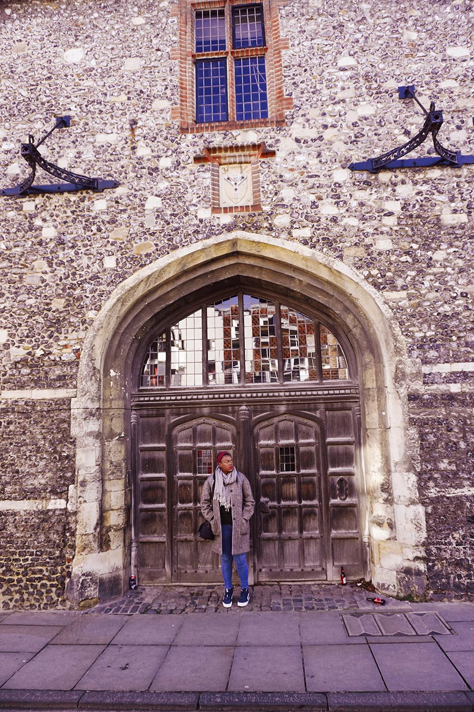 Julianna Barnaby and Medieval gate in Canterbury