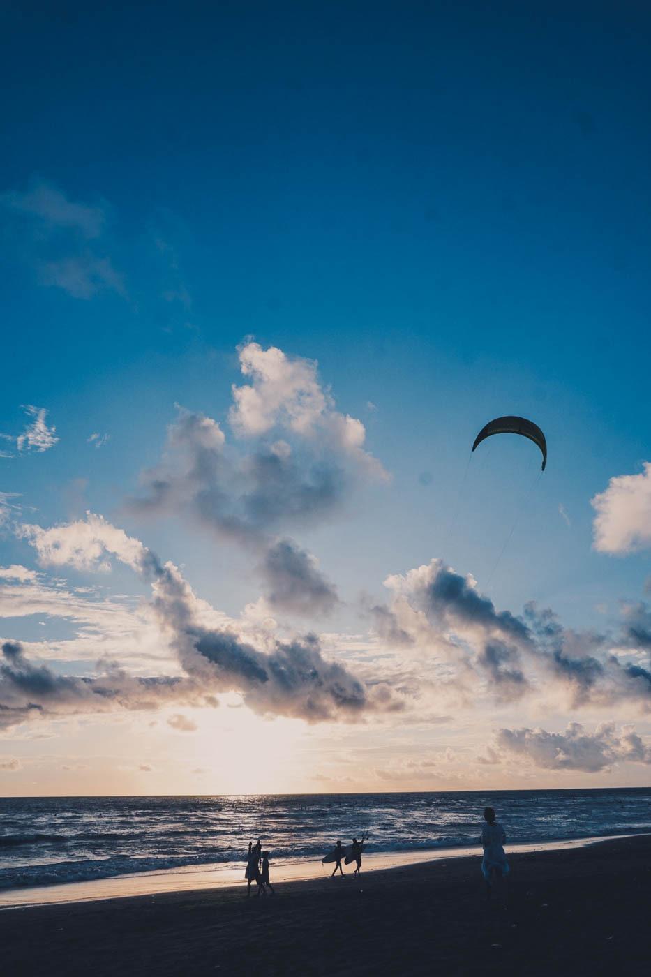 Kitesurfers on the beach in Canggu