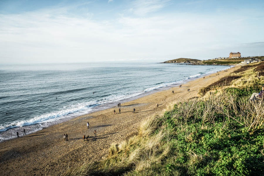 Surfers out on Fistral Beach Cornwall