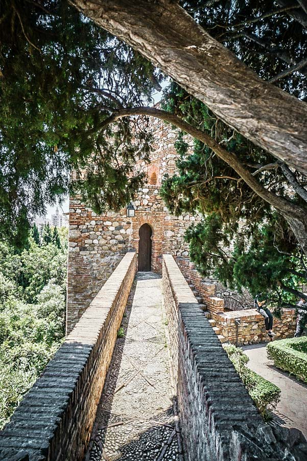 Walkway in the Alcazaba. Malaga, Spain might be best known as a beach destination, but visitor's shouldn't miss the gorgeous Alcazaba palace. Hands down the best thing to do during your travels to Malaga. Here's why... #spain #europe #traveltips