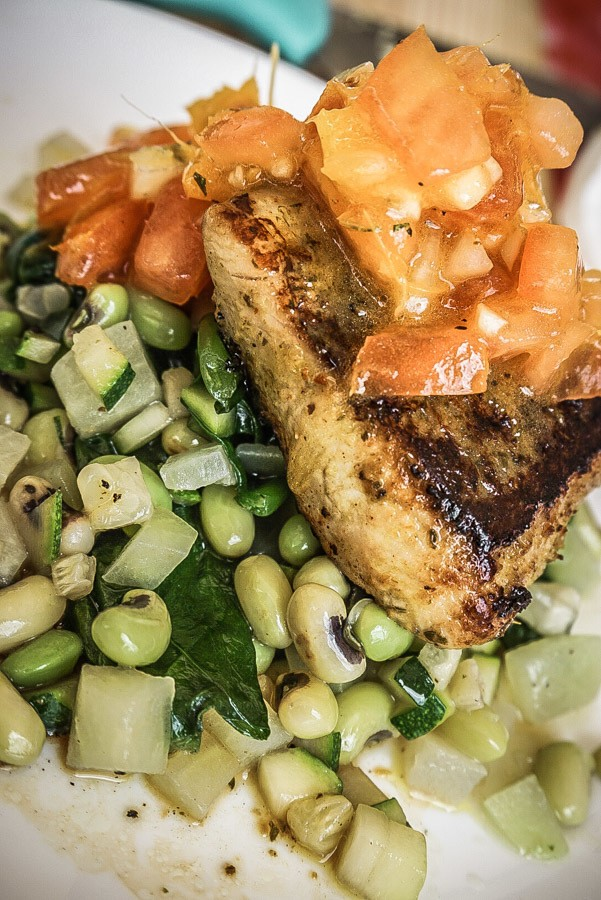Mahi Mahi with vegetables and a tomato salsa. Dreaming of a Caribbean vacation? Nevis is the coolest island in the Caribbean - with a laid-back aesthetic, gorgeous beaches, vibrant culture and cool style and amazing food. Check out my foodie's guide to what to eat and drink in Nevis #travel #caribbean #traveldestinations