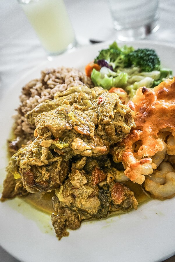 Curried chicken and macaroni pie. Dreaming of a Caribbean vacation? Nevis is the coolest island in the Caribbean - with a laid-back aesthetic, gorgeous beaches, vibrant culture and cool style and amazing food. Check out my foodie's guide to what to eat and drink in Nevis #travel #caribbean #traveldestinations