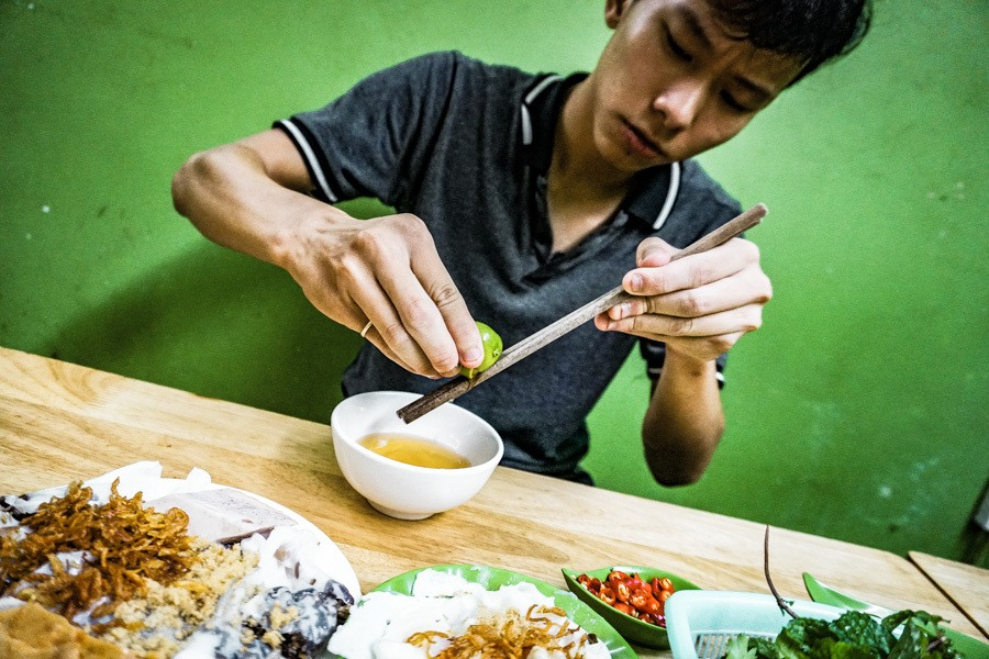 Eating Vietnamese dumplings in Hanoi. Heading to Hanoi, Vietnam? A street food tour should be at the top of your list of things to do. The ultimate self-guided street food tour of the Old Quarter. Don't miss it! #travel #vietnam #food