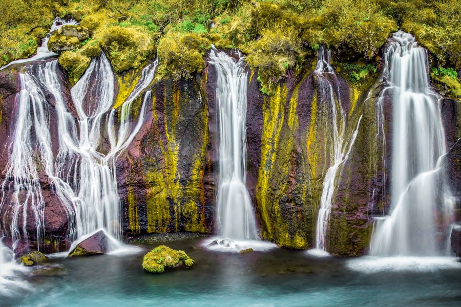 Hrauanfosser - lava falls. 18 incredible waterfalls in Iceland you need to see! Iceland is packed with beautiful places but their waterfalls are really something special. Skogafoss, Gullfoss and more - these places need to be seen to be believed. #beautifulplaces #nature #iceland