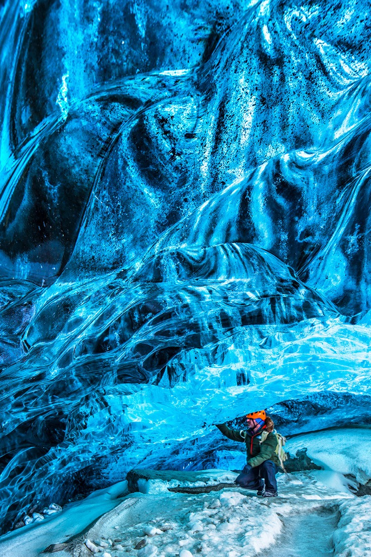 Ice caving in Iceland. Traveling to Iceland on the cheap. It might sound impossible but it can be done. Use my Iceland budget planning guide to help you plan your Iceland adventure #travel #traveltips #iceland