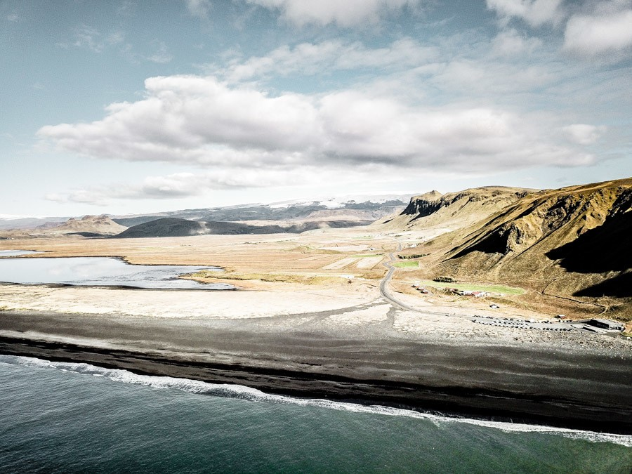 Drone photography of Vik Beach Iceland. Iceland is packed with incredible landscapes and beautiful places. Reynisfjara in Vik is one of them - a black sand beach that proves nature is a drama queen! Pure photography inspiration. #travel #iceland #travelinspiration
