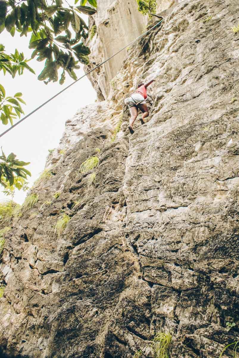 Julianna Barnaby scaling the cliffs at Railay