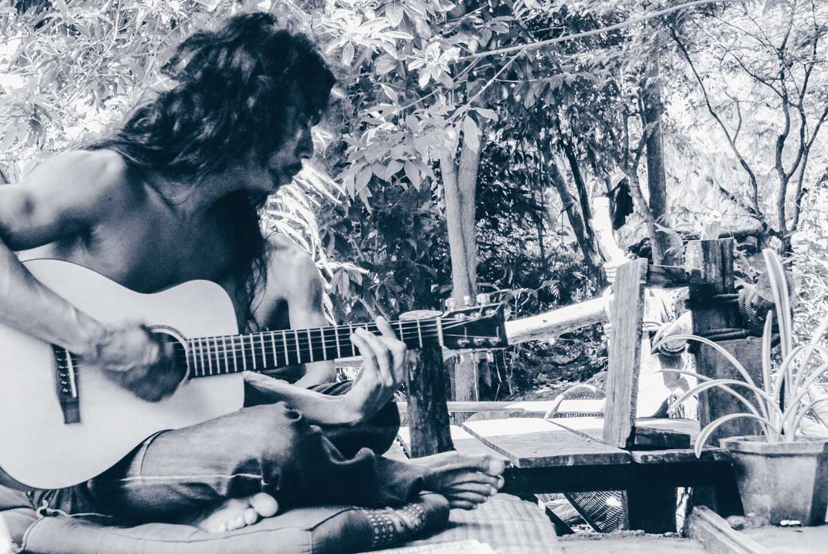 Playing a guitar in Railay